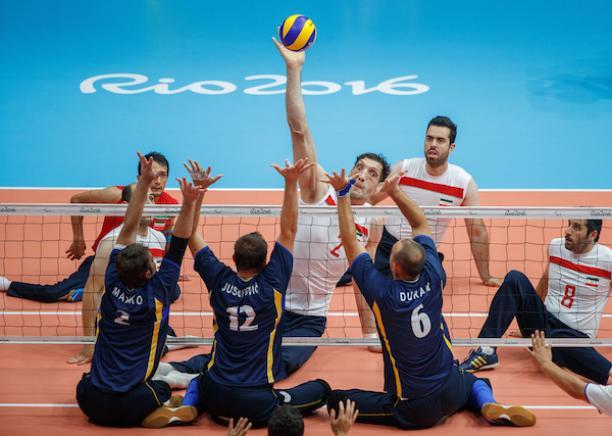 Morteza Mehrzadselakjani IRI stretches to play the ball