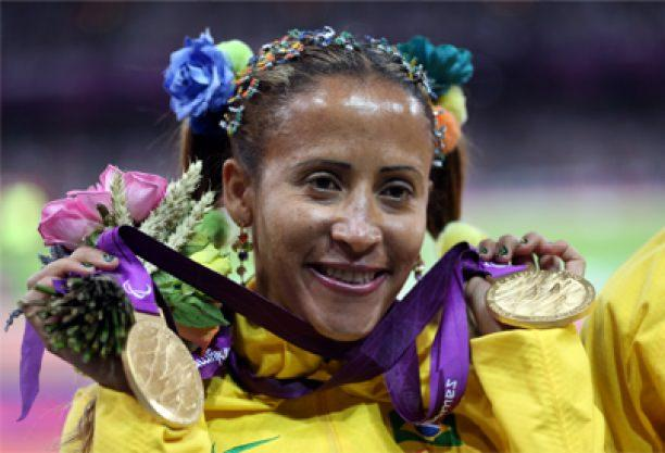 A picture of a woman showing her both gold medals