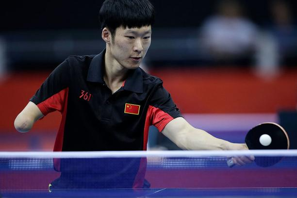 Yang Ge of China returns serve against Sebastian Powrozniak of Poland during the final of the Men's Team Table Tennis - Class 9-10 London 2012