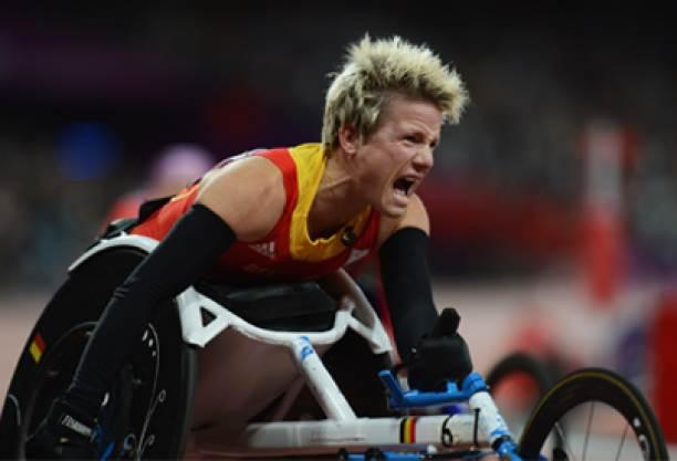 A picture of a woman in a wheelchair screaming after her victory in an athletics race