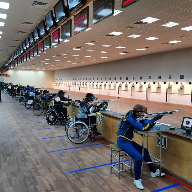 Shooting range with athletes in action