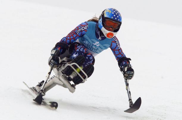 a para alpine skier skies down a slope