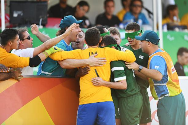 Ricardinho of Brazil and his team mates celebrate after scoring a goal in the men's football 5-a-side