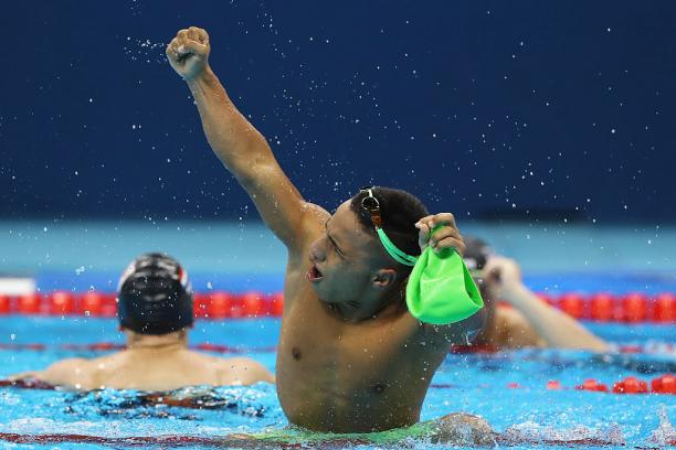 a para swimmer celebrates in the pool