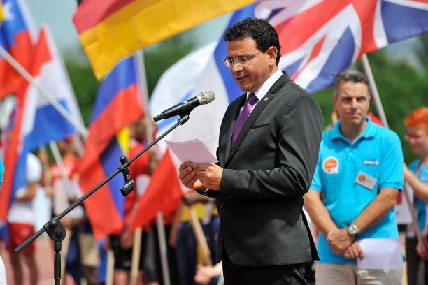 a man speaks at a podium