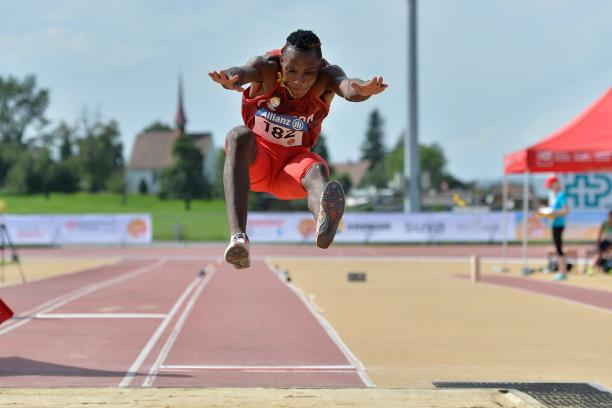 Man competing in long jump event