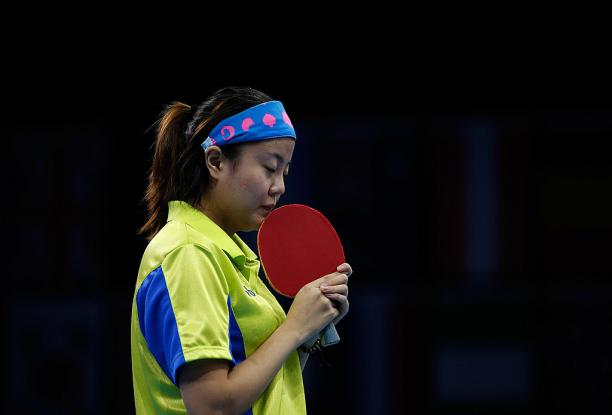 Chinese table tennis player kissing her racket.