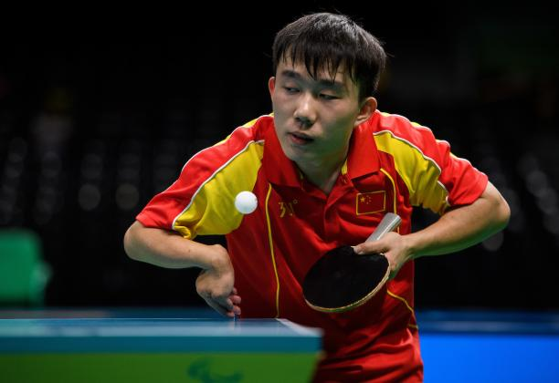 a Para table tennis player goes for a shot