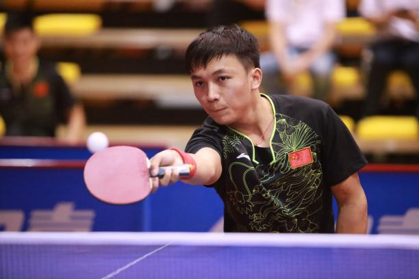 A Para table tennis player takes a shot