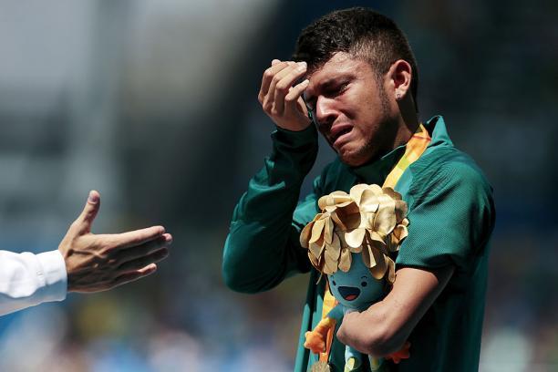 a Para athlete cries on the podium