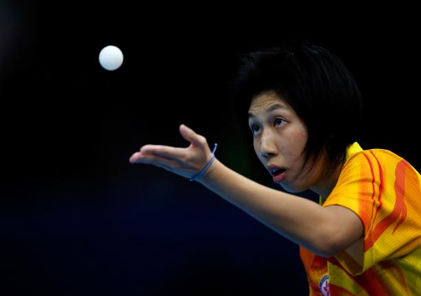Ka Man Wong of Hong Kong serves during her Women's singles Gold medal match against Chi Ka Yeung of Hong Kong at the London 2012 Paralympic Games.