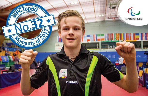 a male Para table tennis player gives a thumbs up to the camera