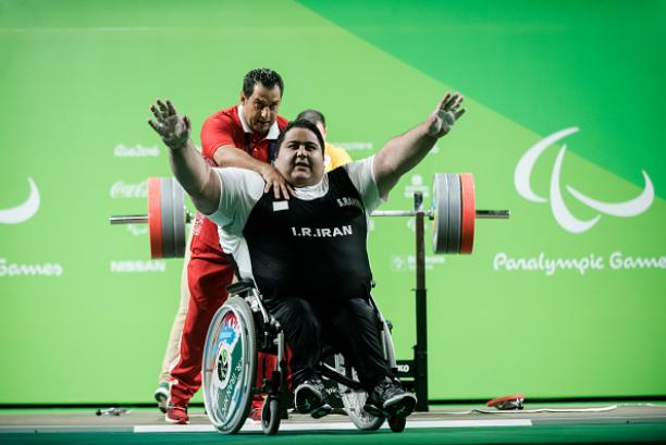 Siamand Rahman of Iran celebrates his new world record on the Powerlifting - Men's +107kg Group A at Riocentro Pavillon 2 at the Rio 2016 Paralympic Games.