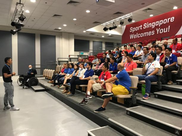 Educator delivers course to audience of coaches and classifiers
