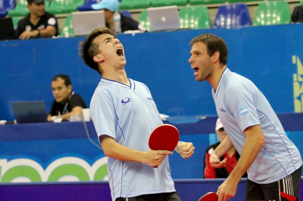 male Para table tennis players celebrate a point