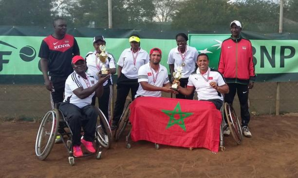 a group of wheelchair tennis players with their trophies