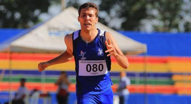 a male Para athlete crosses the finish line