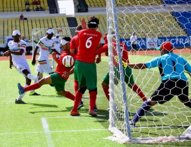 a blind footballer takes a shot