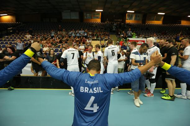 Brazilian goalball player raises arms after winning