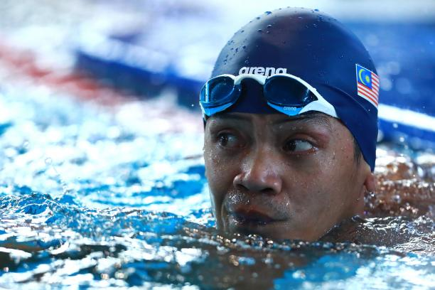 a male Para swimmer in the water