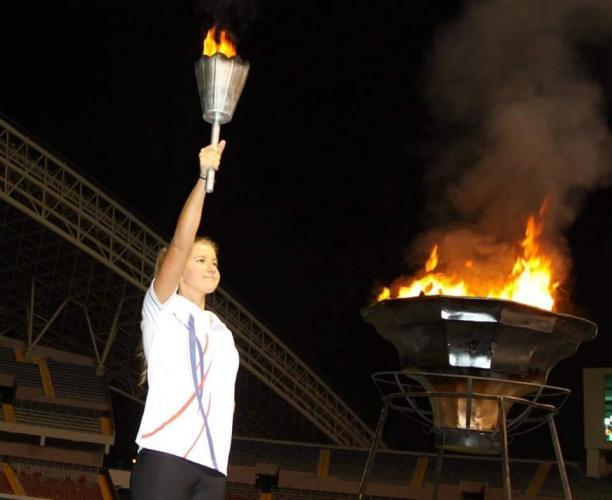 a female Para athlete lighting a cauldron