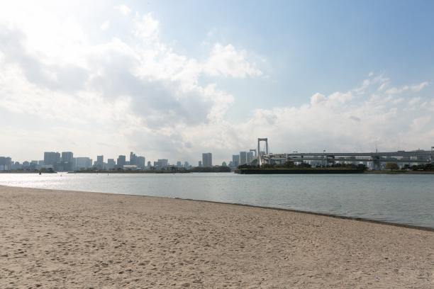 a wide shot of the beach and bay at Odaiba Marine Park in Tokyo