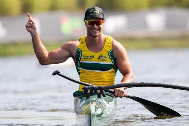 Man in a canoe celebrating