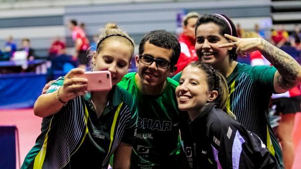 Four people take a selfie