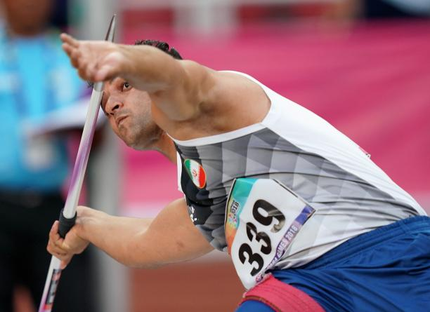 male Para athlete Amanolah Papi prepares to throw a javelin