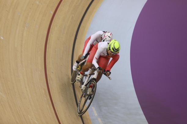 female Para cyclist Emily Lee goes round the track on a tandem cycle