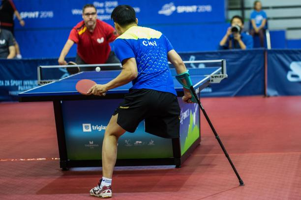 male Para table tennis player Yan Shuo plays a forehand