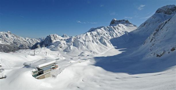 a wide shot of snowy mountains and a chairlift in Sella Nevea