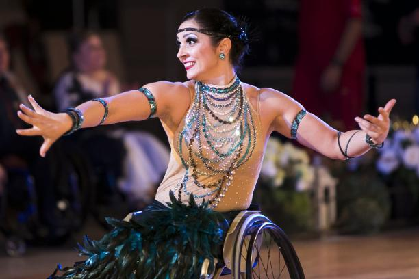 Woman in wheelchair dancing