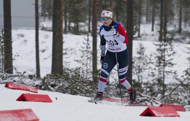 female Para Nordic skier Vilde Nilsen standing and skiing through the snow