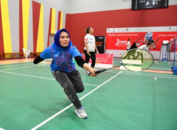Female Para badminton player practices during workshop in UAE