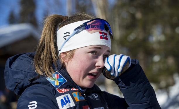 female Para Nordic skier Vilde Nilsen wipes away a tear