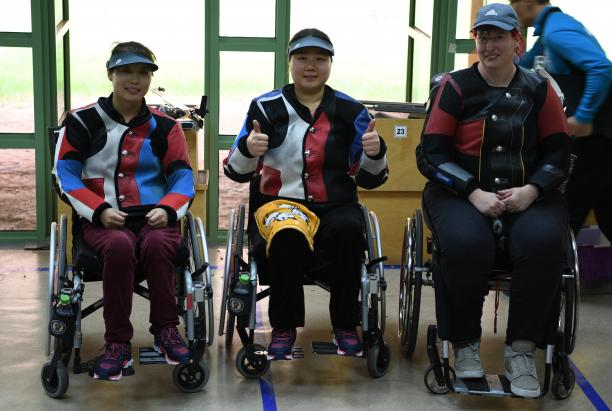 three female Para shooters with Zhang Cuiping giving a thumbs up