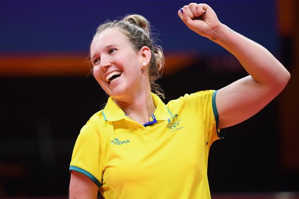 female Para table tennis player Melissa Tapper pumps her fist in victory