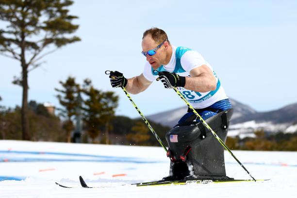 male Para Nordic sit skier Daniel Cnossen pushes through the snow