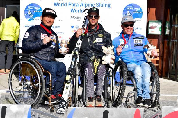 male Para alpine sit skier Igor Sikorski on the podium