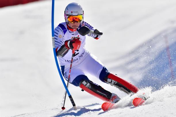 female Para alpine skier Marie Bochet turns through a gate