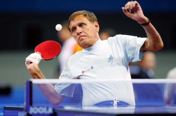 male Para table tennis player Matti Launonen plays a forehand