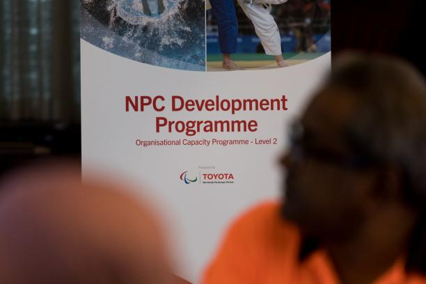 Banner of the Agitos Foundation NPC Development Programme displayed during workshop