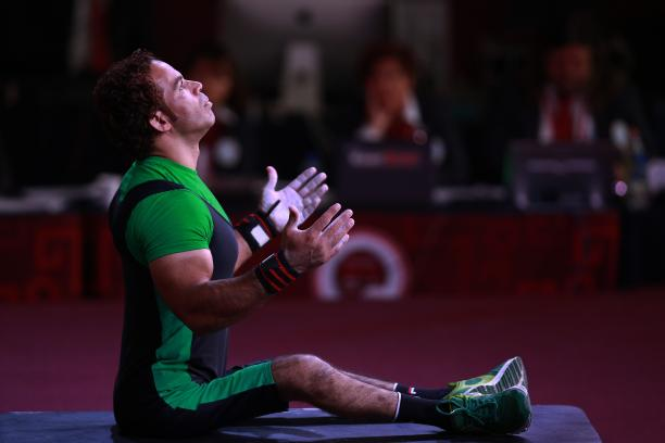 a male powerlifter prepares on the bench