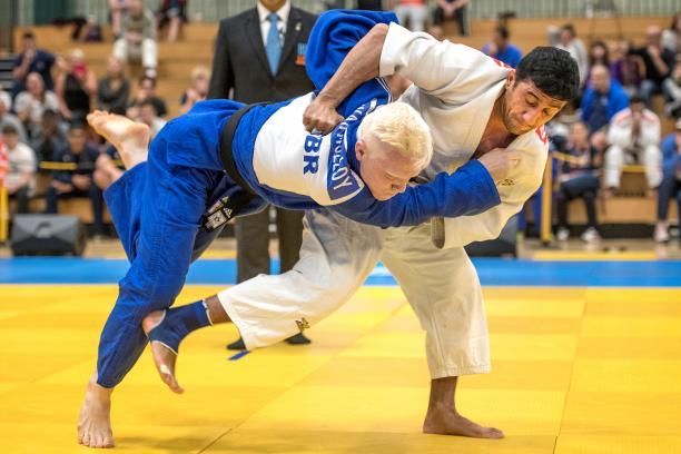 male judoka Ramil Gasimov wrestles another judoka to the ground
