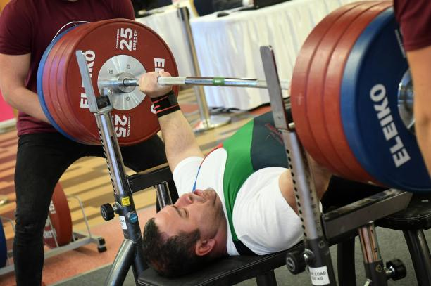 male Para powerlifter Elshan Huseynov prepares to lift the bar
