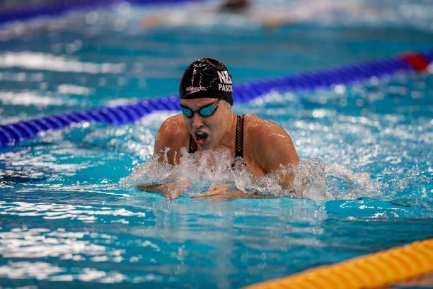 A woman swimming breaststroke