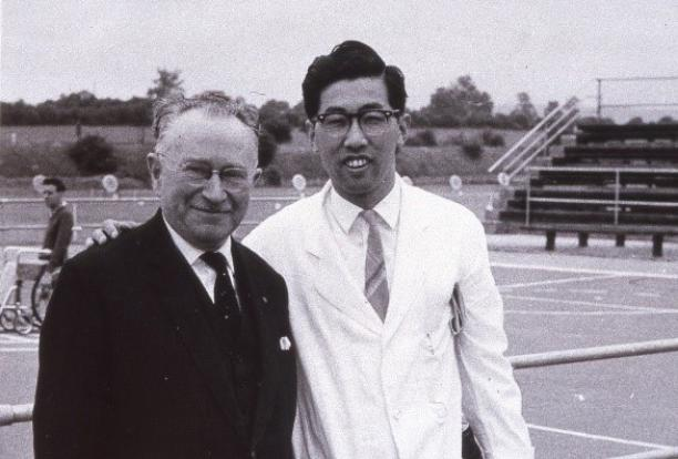 Black and white photo of Japanese man posing with Sir Ludwig Guttman