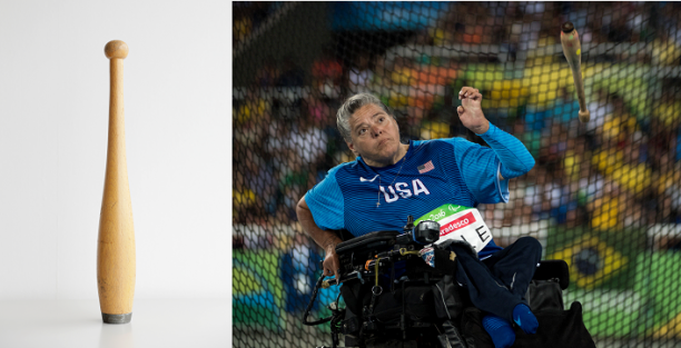 A wooden club and a woman in a power chair throwing a club