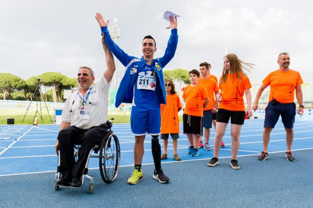male Para athlete Lorenzo Marcantognini celebrates waving on the podium